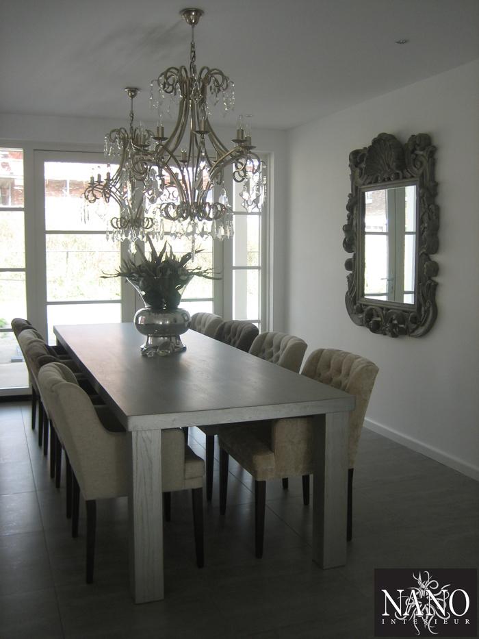 https://www.nanointerieur.nl/resize/woonhuis-den-haag-houten-tafel-stoelen-spiegel-en-kroonluchters_16882507563779.jpg/woning-den-haag-630.jpg